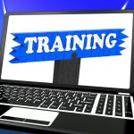 Training On Laptop Shows Coaching And Online Lessons